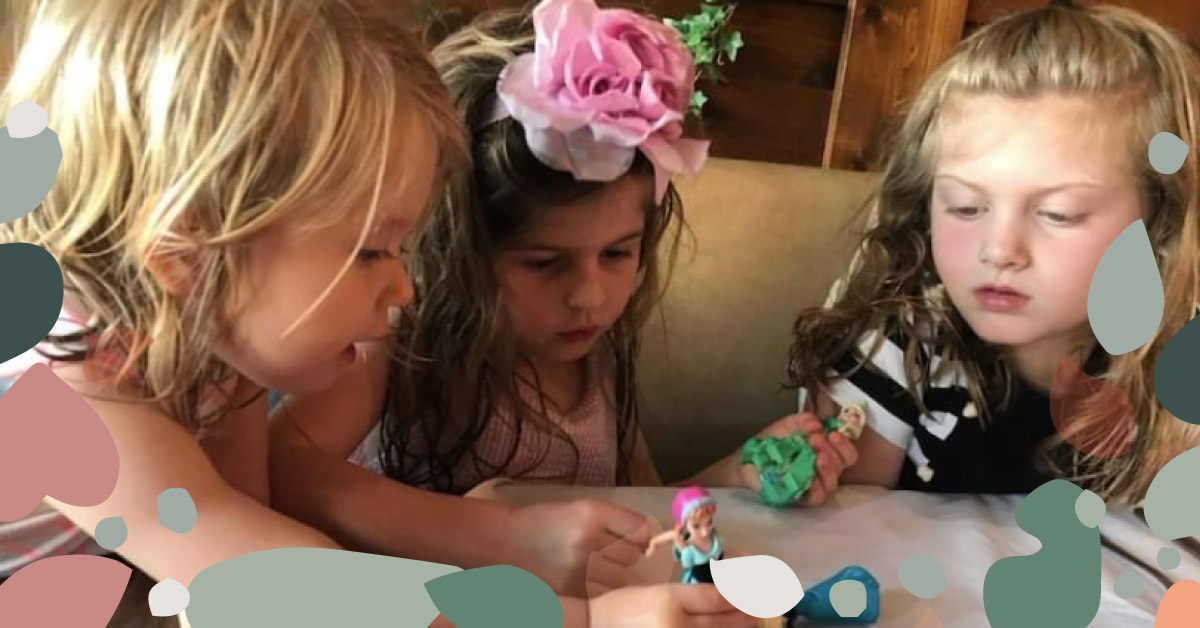image of three children playing with toys