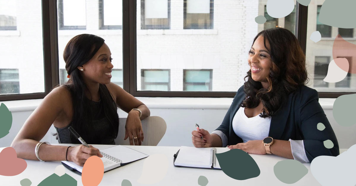 image showing two bipoc women talking and laughing